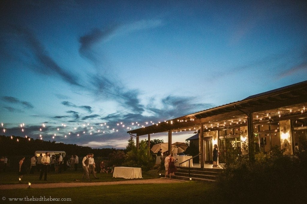 Pecan Springs Ranch reception lawn at night.