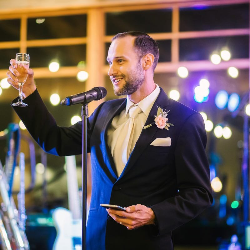 Best man gives toast at wedding reception