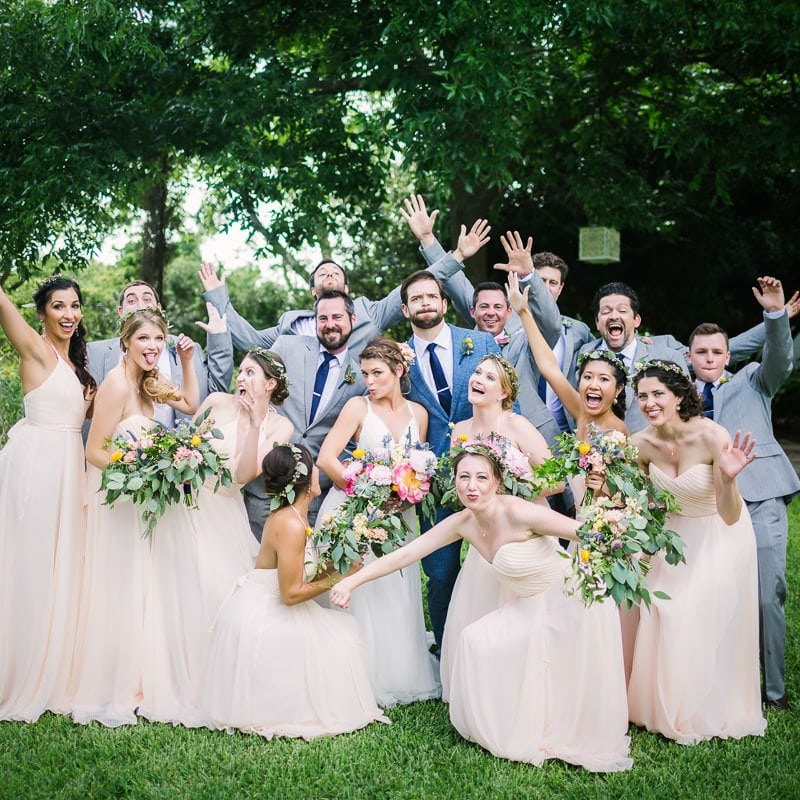 Bridal party makes silly pose for a photo