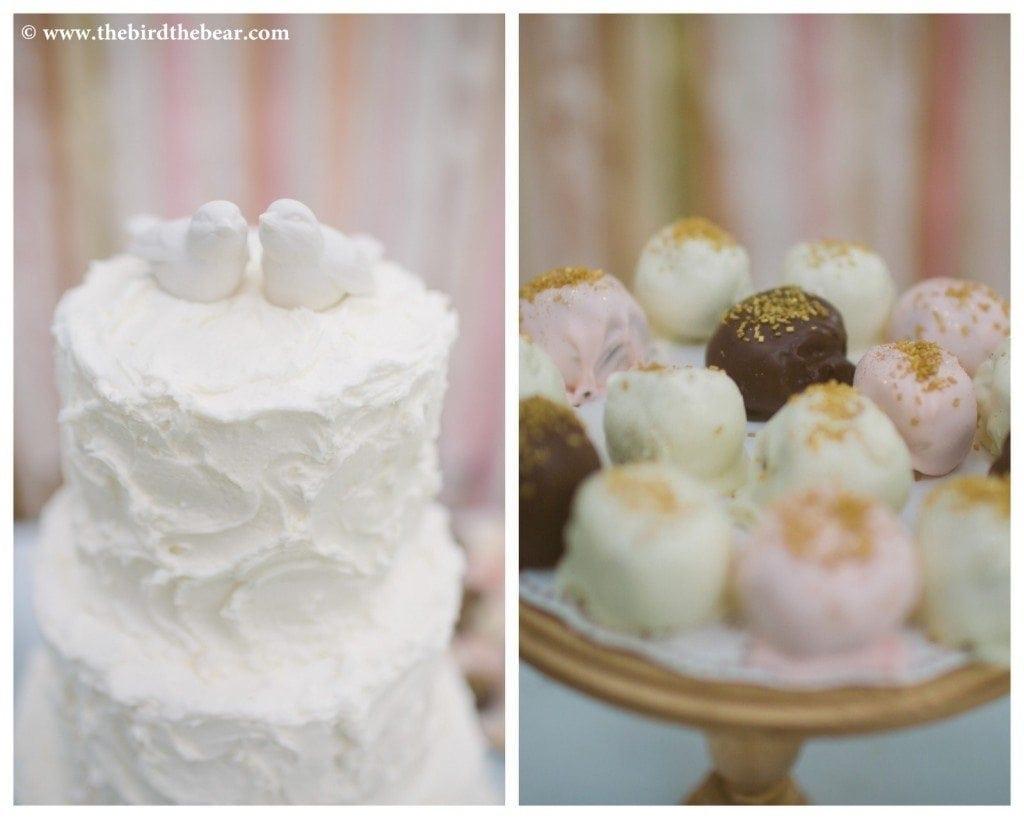 A white wedding cake with white birds on top.
