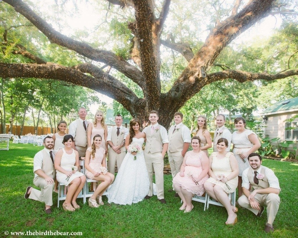 Bridal party under the large Oak tree at Oak Tree Manor in Spring, TX.