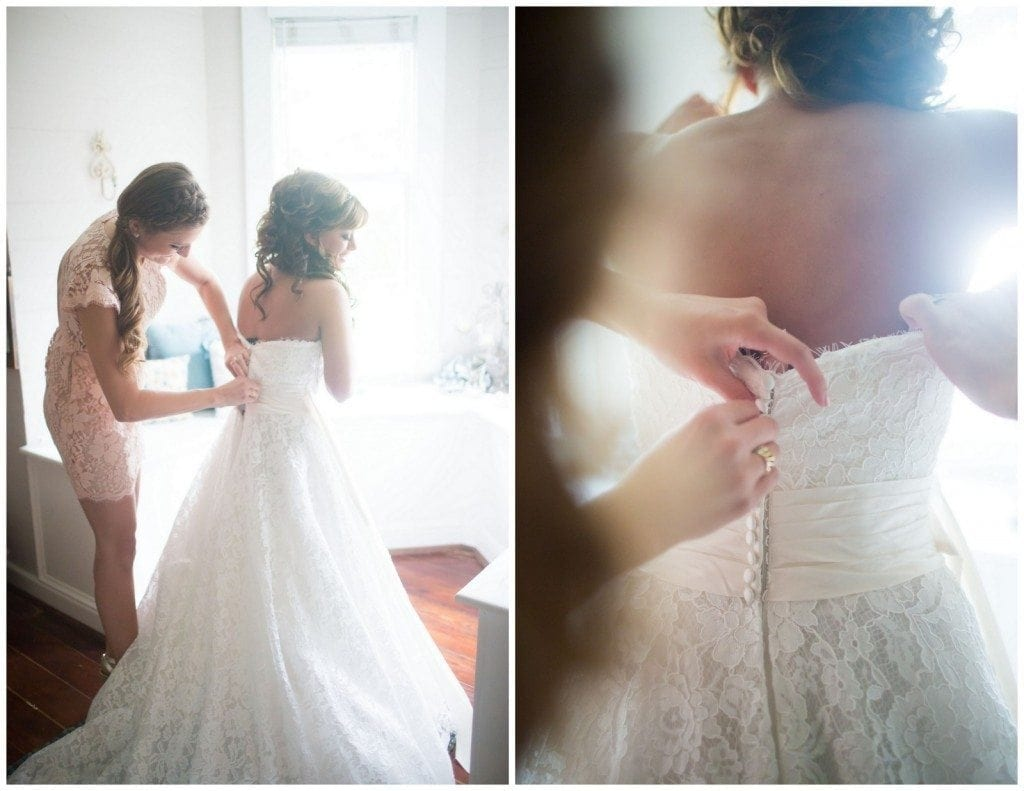 The bride puts on her dress upstairs the home in Oak Tree Manor.