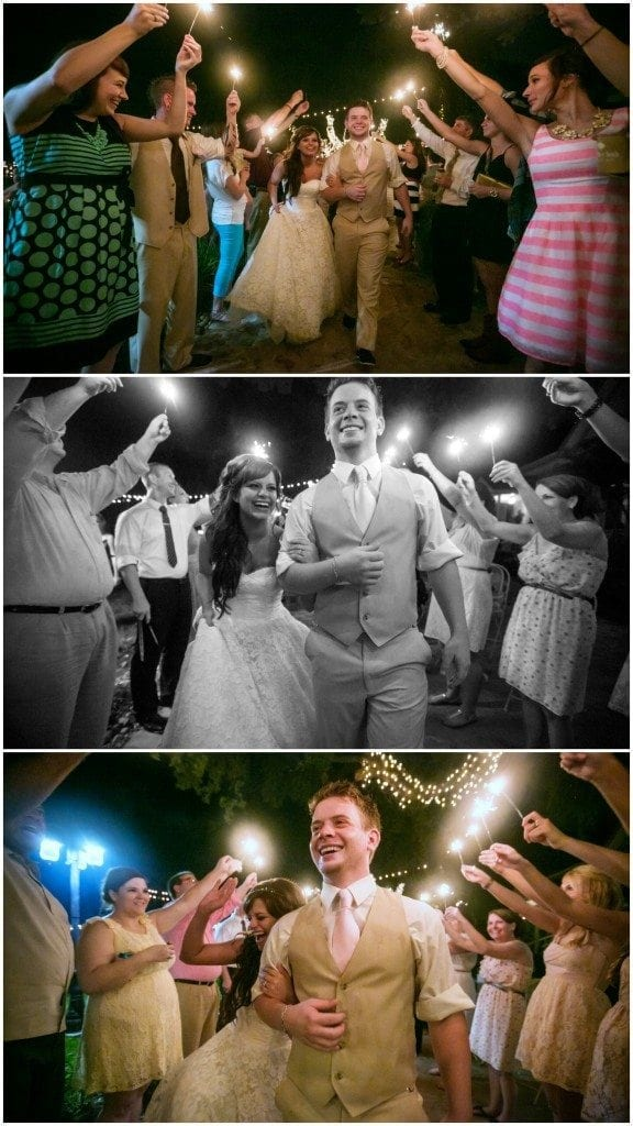 Bride and groom run through sparklers as they exit their Oak Tree Manor wedding reception.