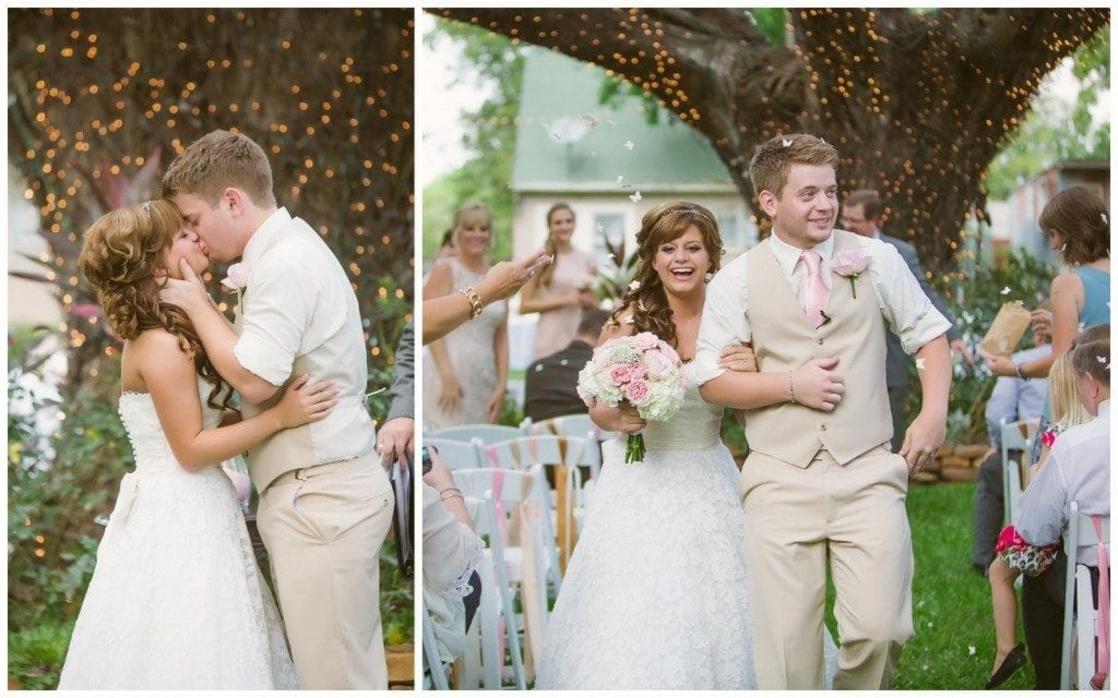The bride and groom share their first kiss as husband and wife underneath the big oak tree at Oak Tree Manor in Spring, TX.