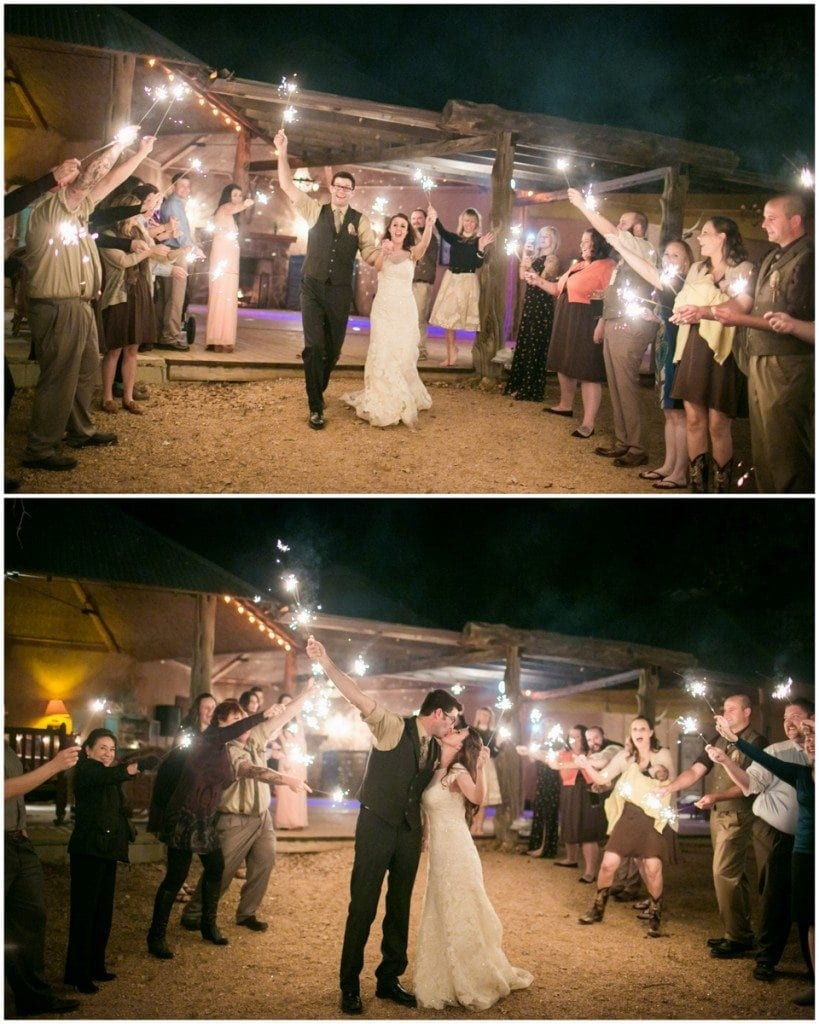 The bride and groom run through a crowd of sparklers after their wedding at Three Points Ranch.