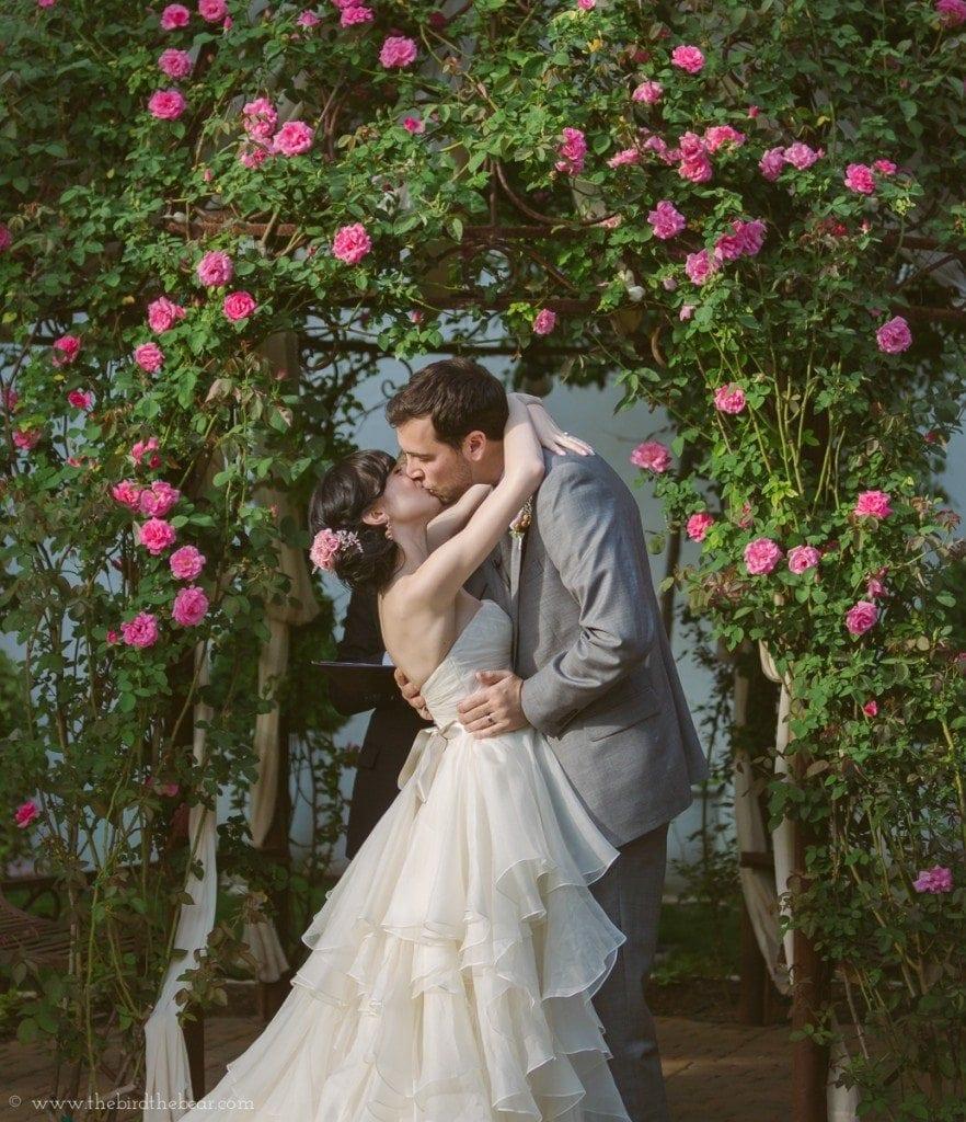 first kiss at a wedding at the hummingbird house in austin, tx