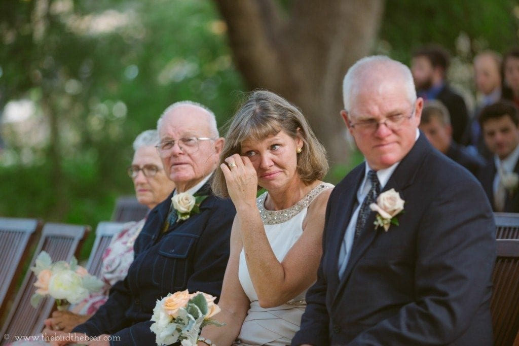 The groom's mother sheds a tear during the wedding ceremony.
