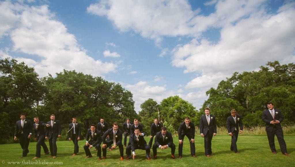 Groom and groomsmen play football before the wedding ceremony.
