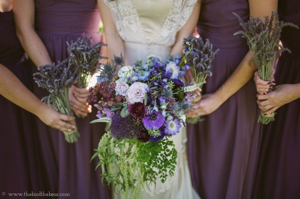 purple wedding bouquets with plum bridesmaids