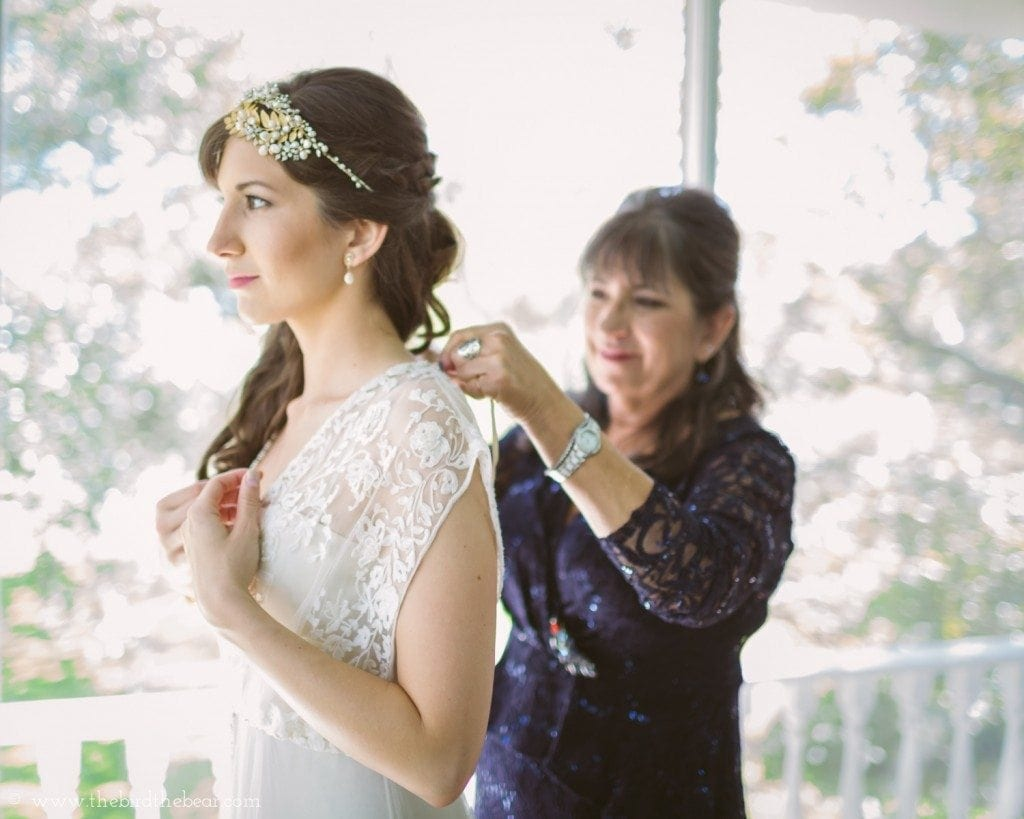 mother of the bride helps bride put her bhldn dress on before her wedding at the winfield inn in kyle tx