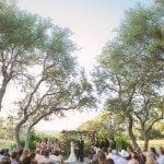 Wedding ceremony under the trees at vista west ranch