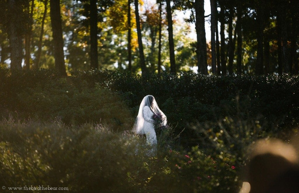 Awesome wedding photo of bride walking down a mountain to her groom during her wedding ceremony