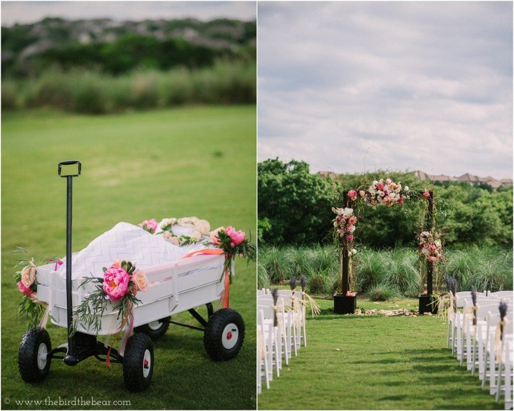 Wagon for a baby flower girl to ride in, decorated with bright pink flowers.