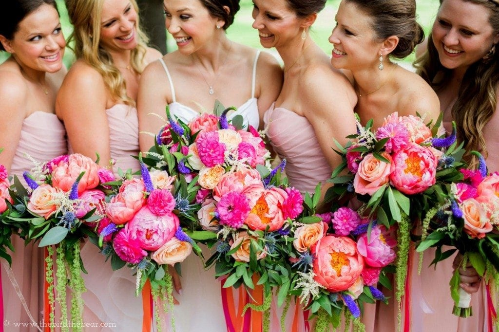 Vibrant coral and fuscia wedding flowers.