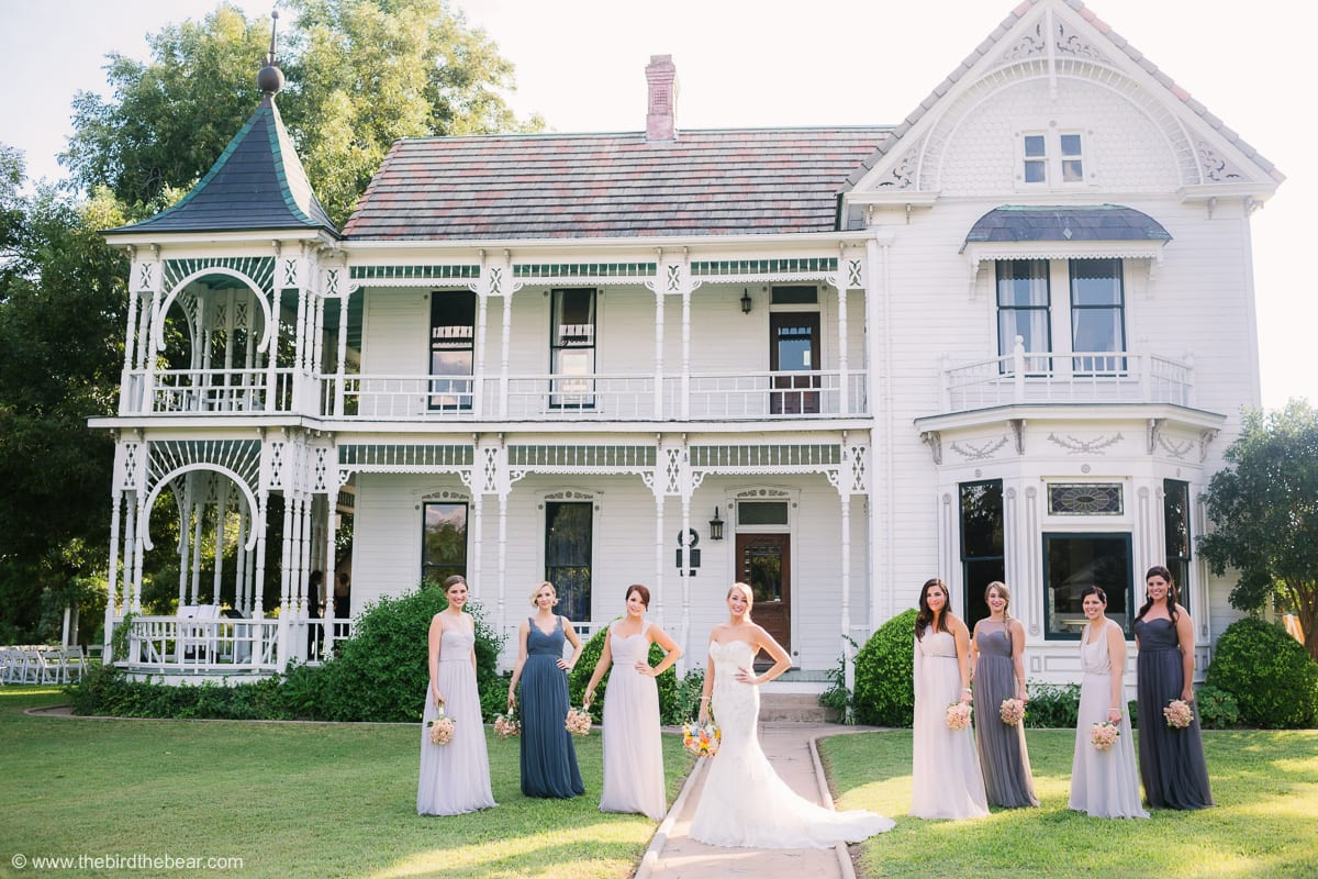 Bride And Bridesmaids Standing In Front Of The Art Deco House At Barr Mansion Austin
