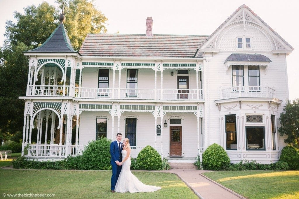 Bride and Groom in front of gorgeous mansion