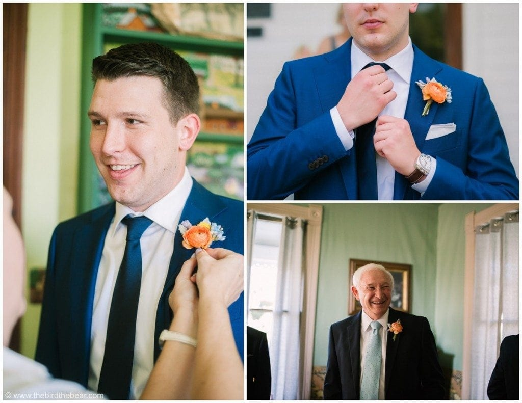 Groom getting his boutineer pinned on and grandpa smiles